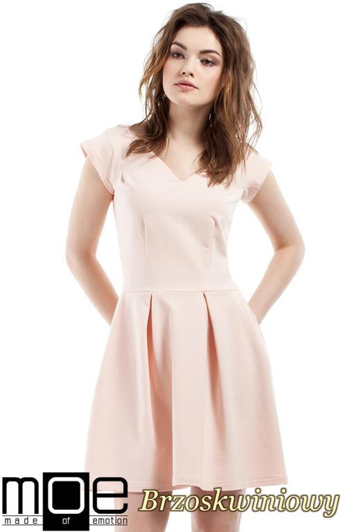 cba1455c4c CM2212 Elegancka sukienka z kontrafałdami - brzoskwiniowa w sklepie  internetowym Cudmoda. Powiększ zdjęcie